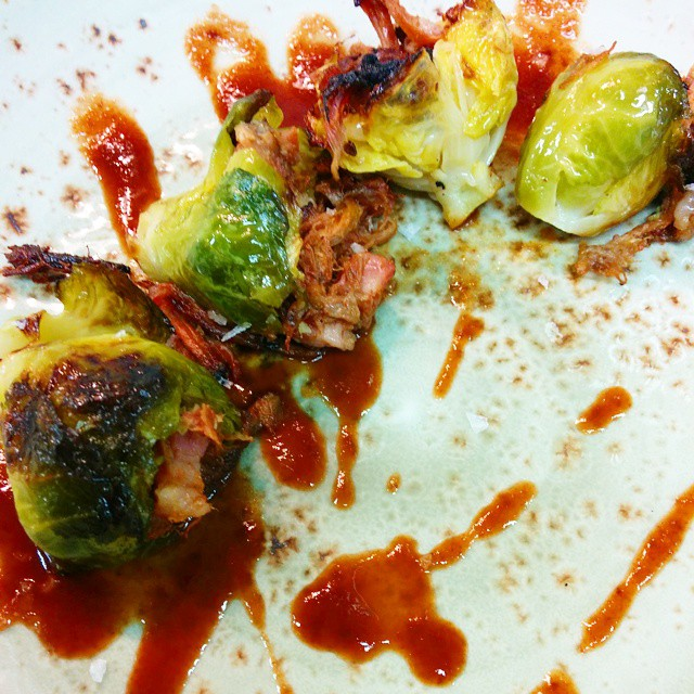 Pulled hock bbq'd brussel sprouts. Hot sauce. Absolutely delicious bite